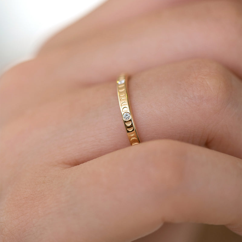 Moon Phase Ring with Full Moon Diamonds - Thin side angle on hand up close