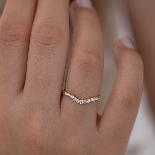 Curved Diamond Wedding Band on hand