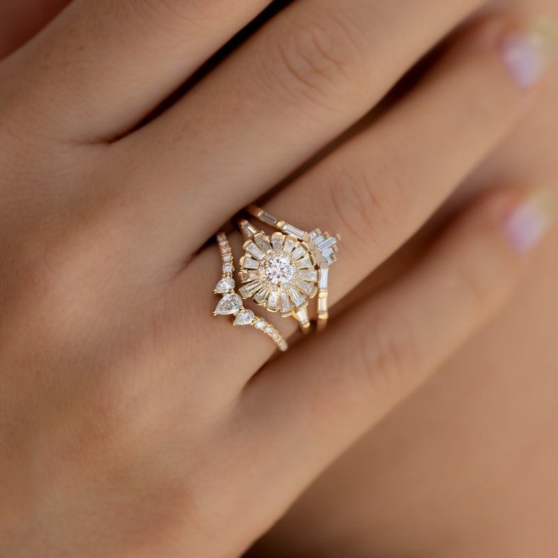 Nesting-Diamond-Ring-with-Three-Pear-Cut-Diamonds-in-set-on-finger