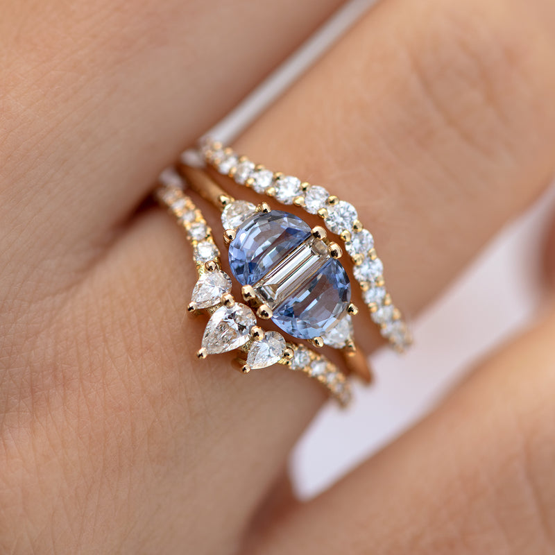 Nesting-Diamond-Ring-with-Three-Pear-Cut-Diamonds-on-finger