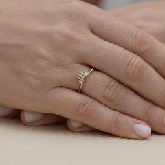 Nesting-Wedding-Ring-with-Baguette-Diamonds-S-set-on-finger
