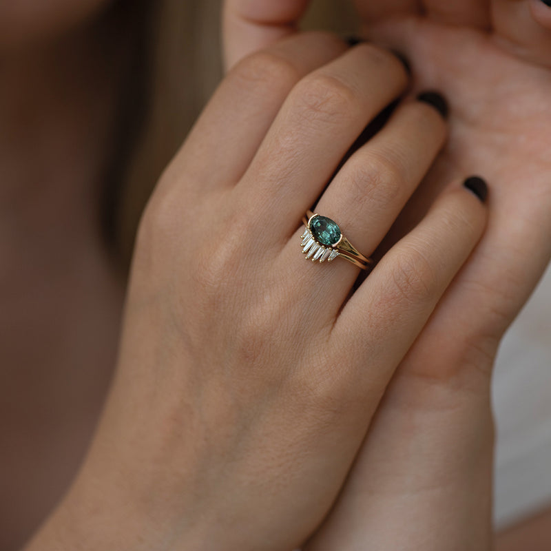 Nesting-Wedding-Ring-with-Baguette-Diamonds-on-finger