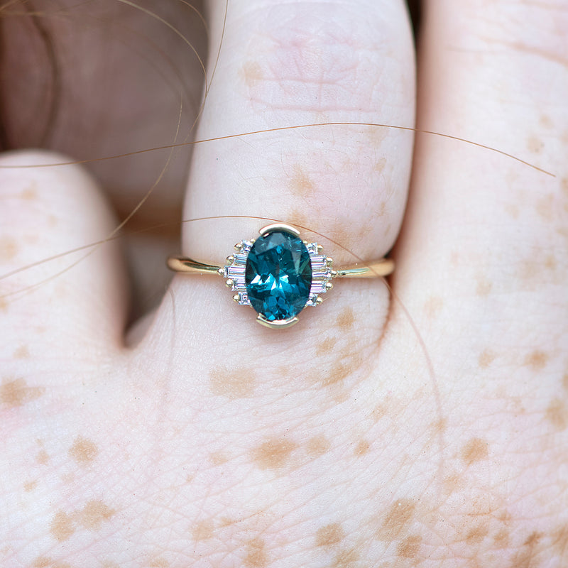 OOAK-Oval-Cut-Teal-Sapphire-Engagement-Ring-with-White-Diamond-Wings-freckles-moment