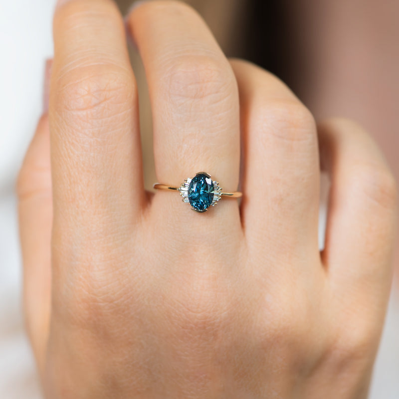 OOAK-Oval-Cut-Teal-Sapphire-Engagement-Ring-with-White-Diamond-Wings-moment