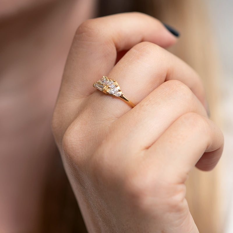 Gliding Tapered Baguette Cluster Ring on finger