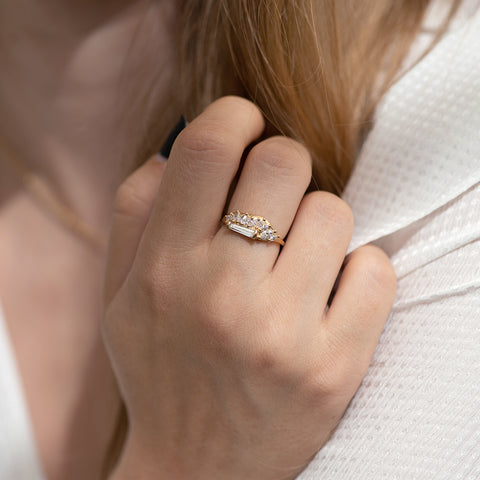 Gliding Tapered Baguette Cluster Ring closed hand