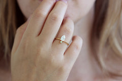 One Carat Diamond With Tiny Mint Garnet Ring On Ring Finger