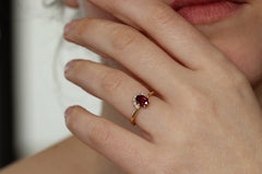 One Carat Ruby And Diamonds Engagement Ring On Hand