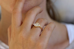 One Carat Trillion Cut Diamond Engagement Ring on finger