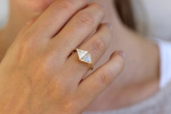 One Carat Trillion Cut Diamond Engagement Ring on hand