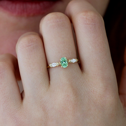 mint engagement ring on hand