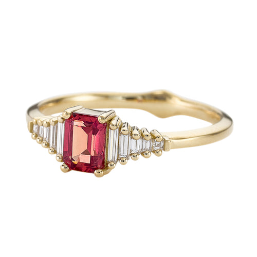 Padparadscha-Sapphire-Engagement-Ring-with-Baguette-Diamond-Detailing-closeup