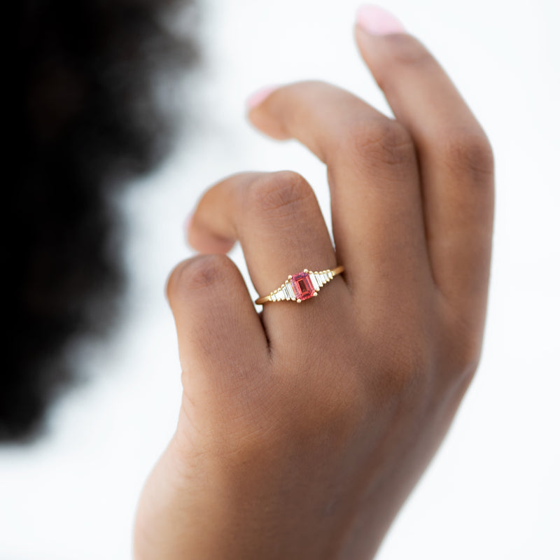 Padparadscha-Sapphire-Engagement-Ring-with-Baguette-Diamond-Detailing-glistening