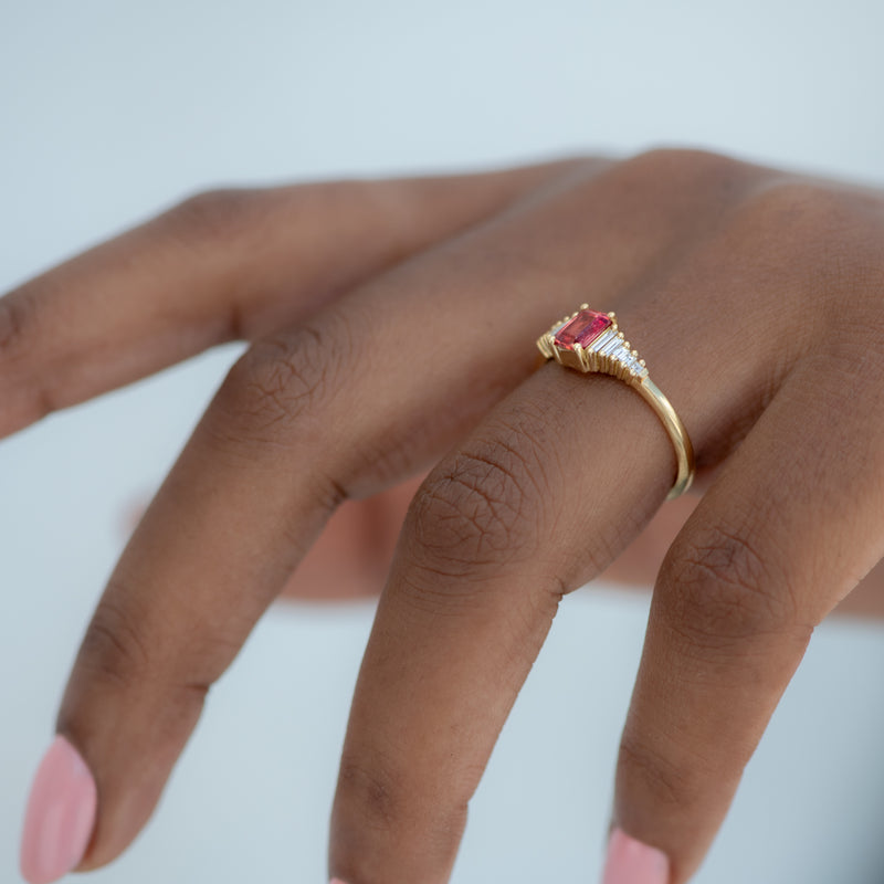 Padparadscha-Sapphire-Engagement-Ring-with-Baguette-Diamond-Detailing-side-shot