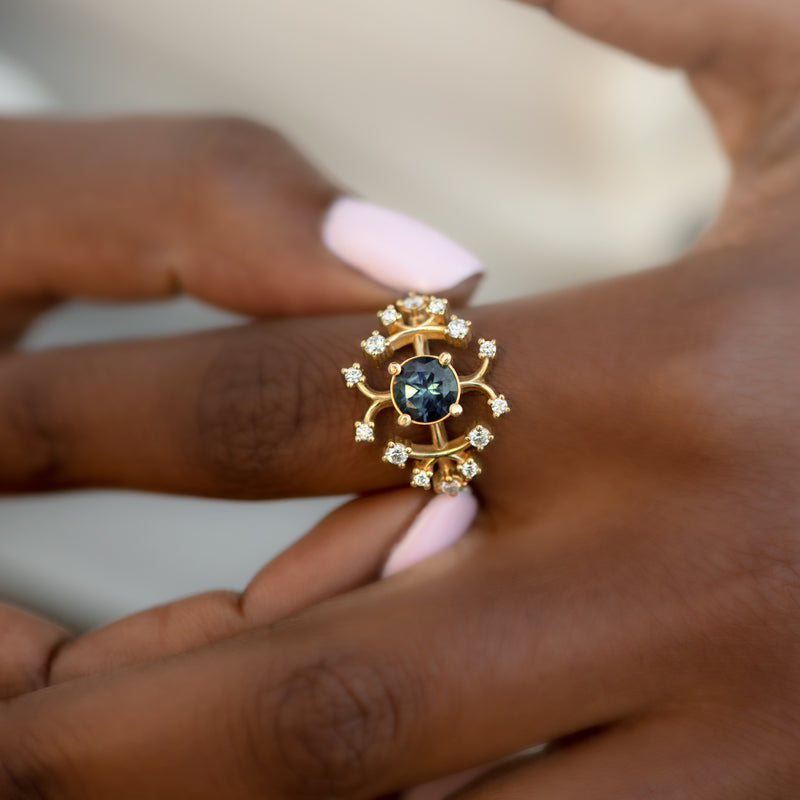 Parti-Sapphire-Engagement-Ring-with-Brilliant-Cut-Diamonds-ON-FINGER