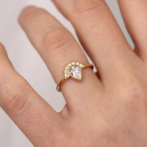 Pear Cut Halo Engagement Ring On Finger