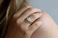Pear Diamond Cluster Ring In A Set On Finger