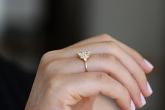 Pear Diamond Cluster Ring On Ring Finger
