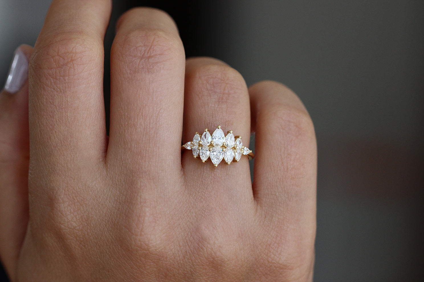 Pear Diamond Cluster Ring On Finger