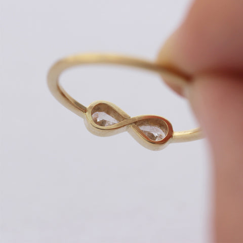 Pear Diamonds Infinity Ring In Hand