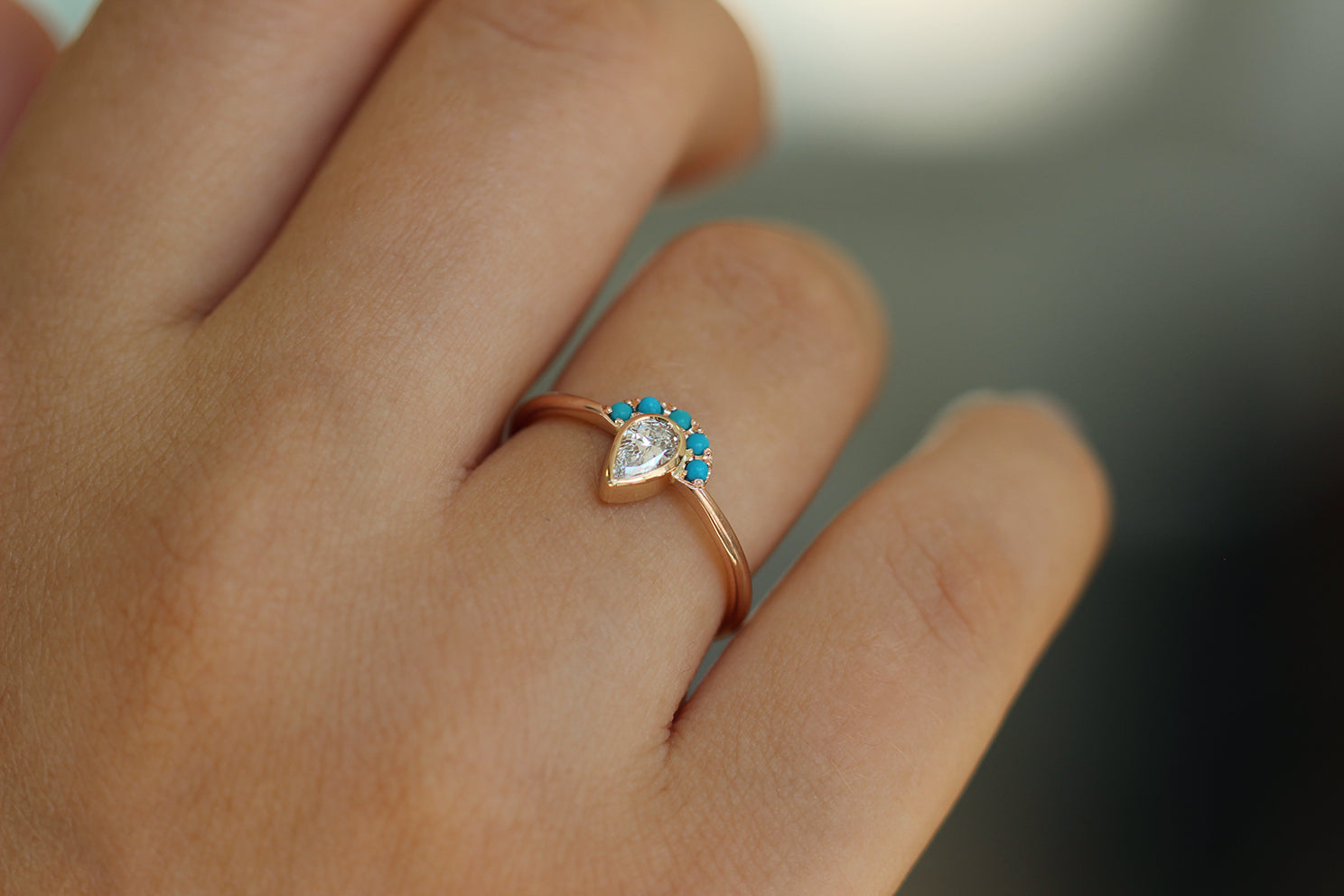 Pear Cut Diamond Ring - Turquoise Crown Diamond Ring on Hand Up Close