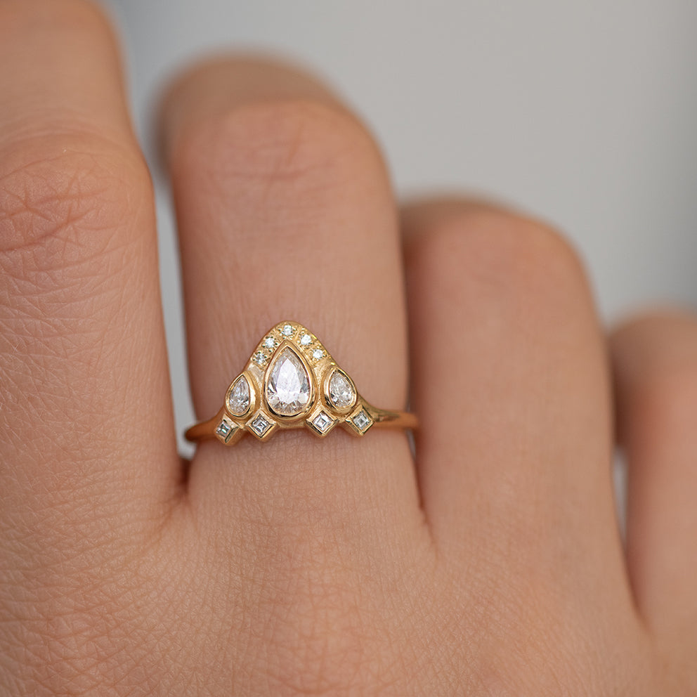 Pear Shaped Diamond Ring on Hand Detail Shot