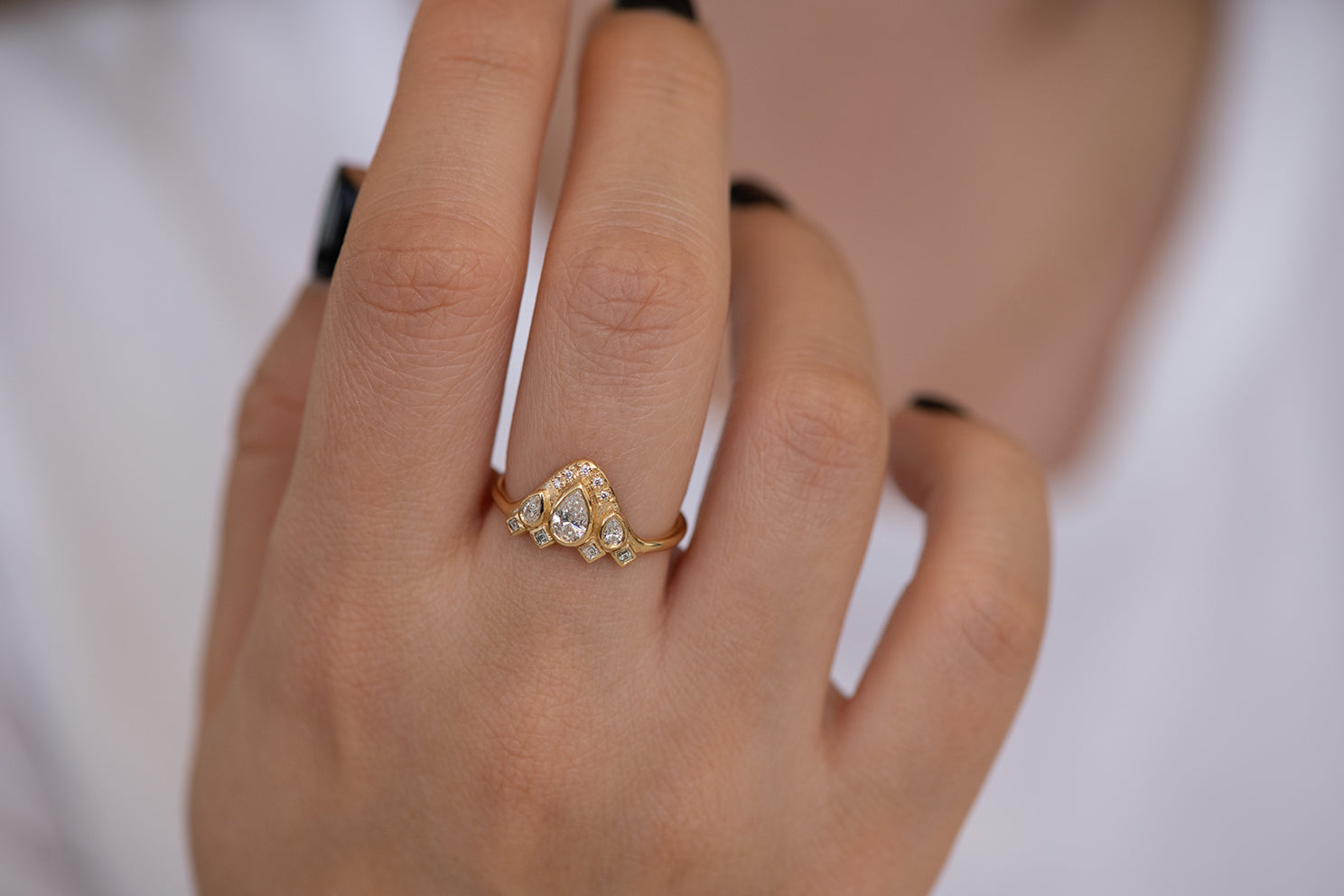 Pear Shaped Diamond Ring on Hand Top Down View