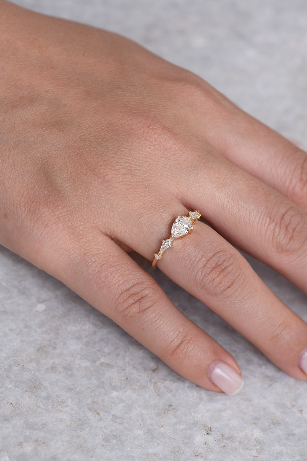 Pear Shaped Engagement Ring - Diamond Lineup Ring Look Down View in Sunlight