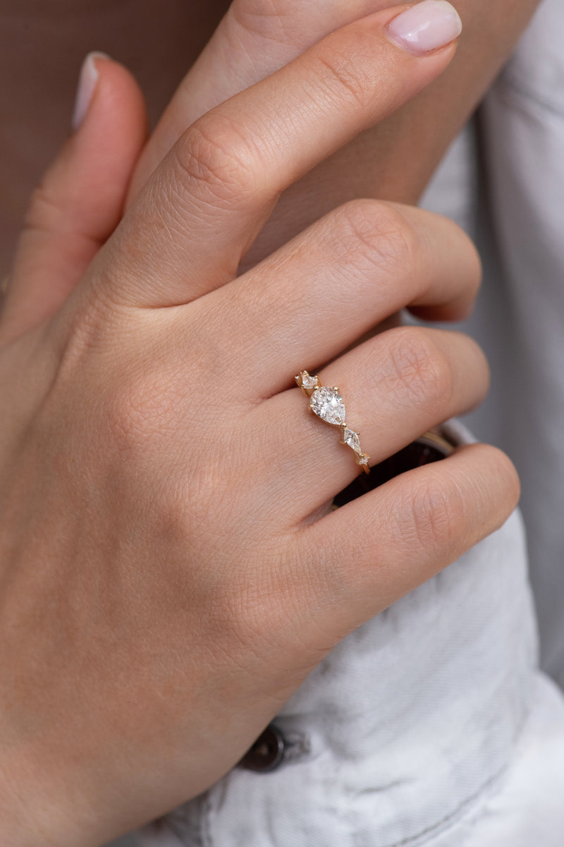 Pear Shaped Engagement Ring - Diamond Lineup Ring on Hand