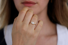 Pearl Engagement Ring On Woman's Finger