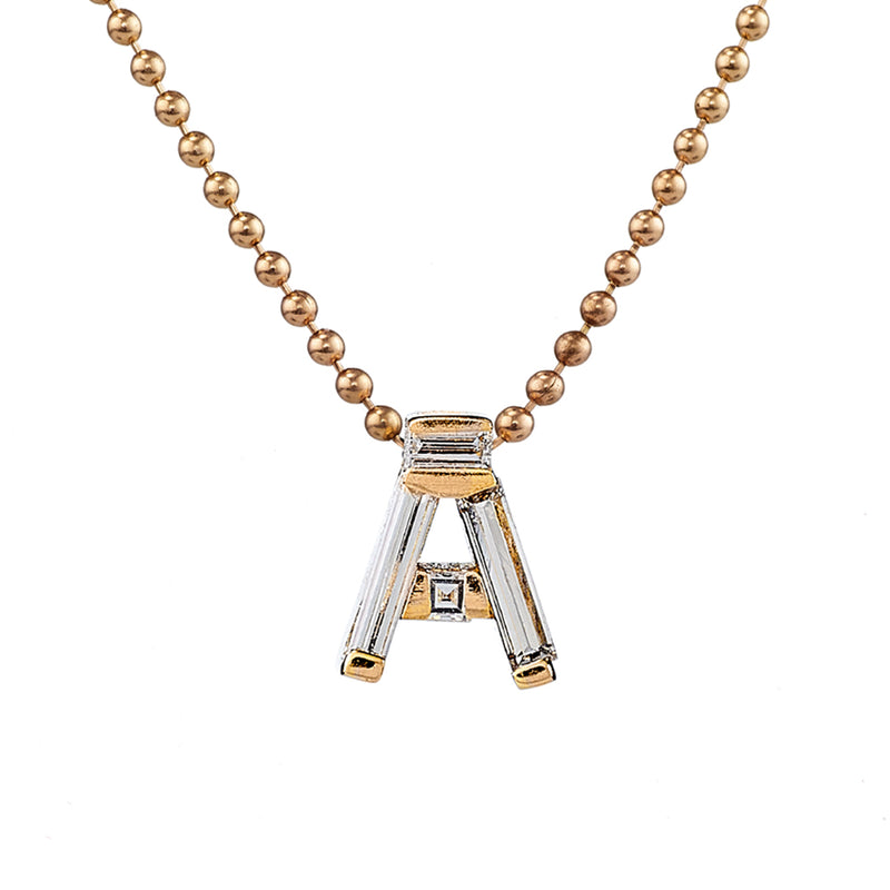 Personalised-Initial-Necklace-with-Baguette-Diamonds-freckles-closeup