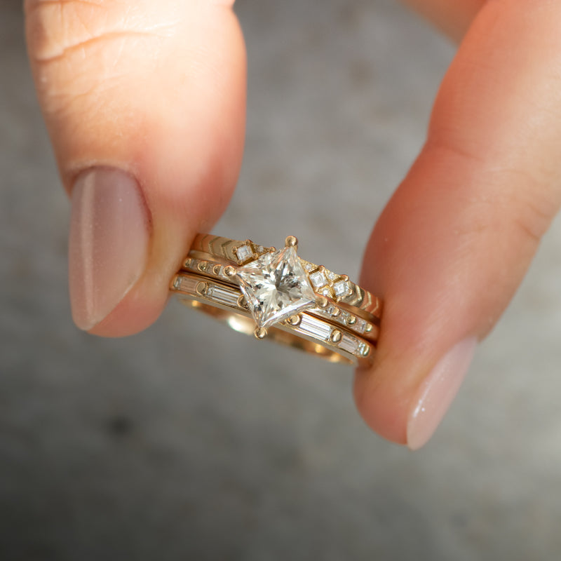 Princess-Cut-Solitaire-Engagement-ring-with-Baguette-Diamond-Detailing-OOAK-hold-in-hand-in-set