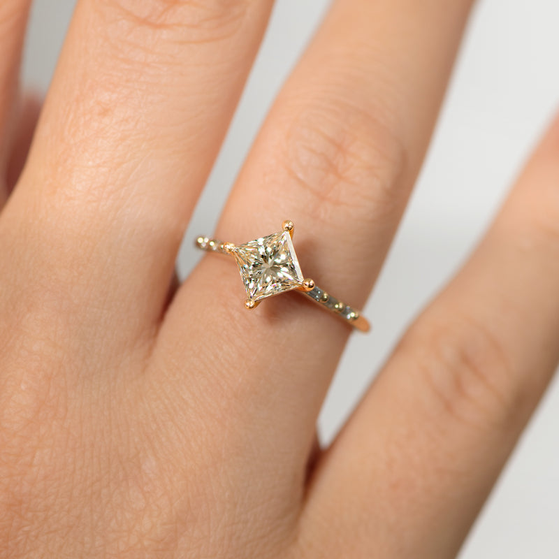 Princess-Cut-Solitaire-Engagement-ring-with-Baguette-Diamond-Detailing-OOAK-on-finger