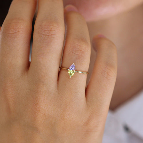 Purple Spinel and Yellow Saphirring on finger