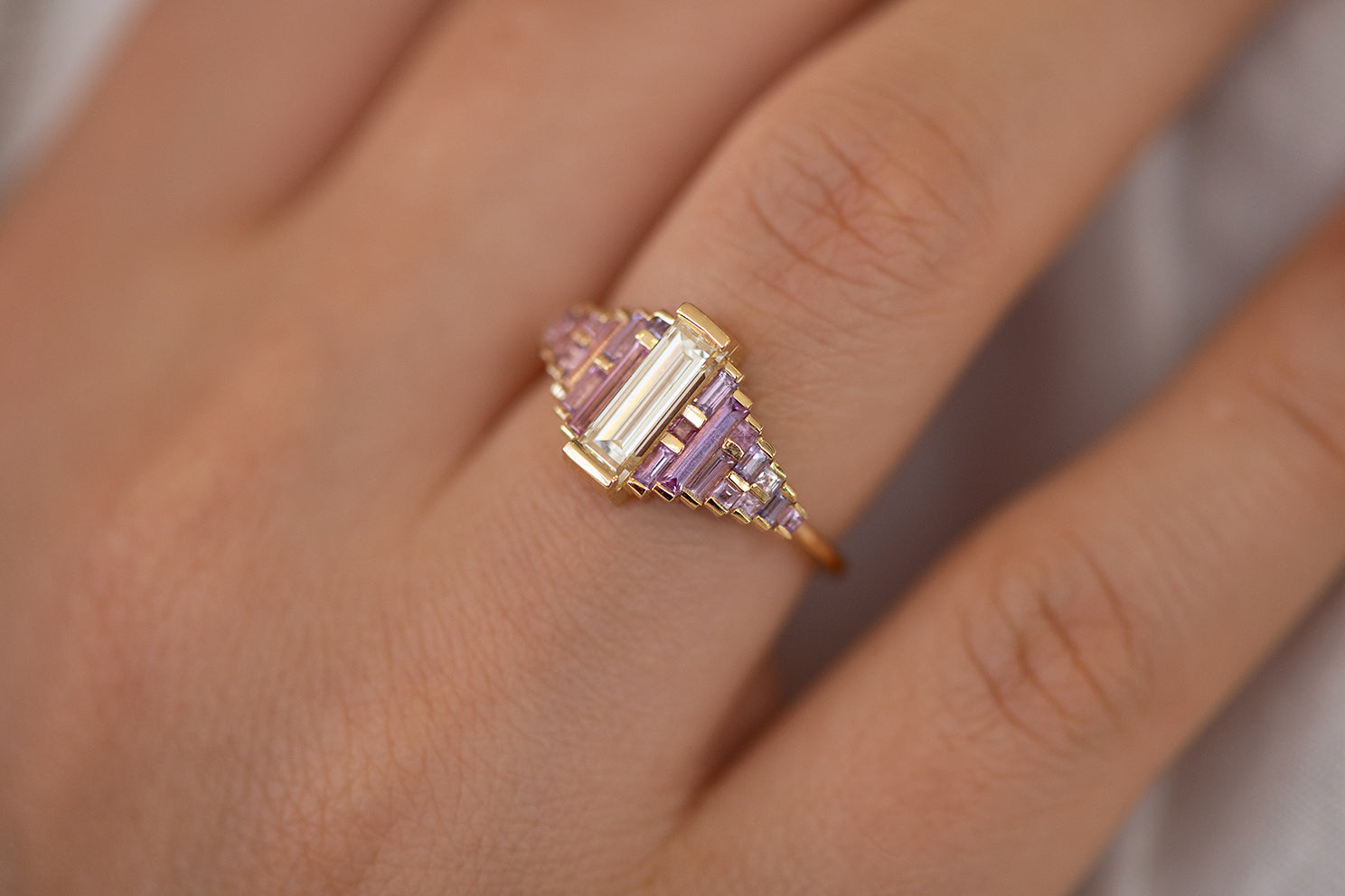 Purple and Lilac Sapphire Ring with Baguette Diamond Detail Shot on Finger
