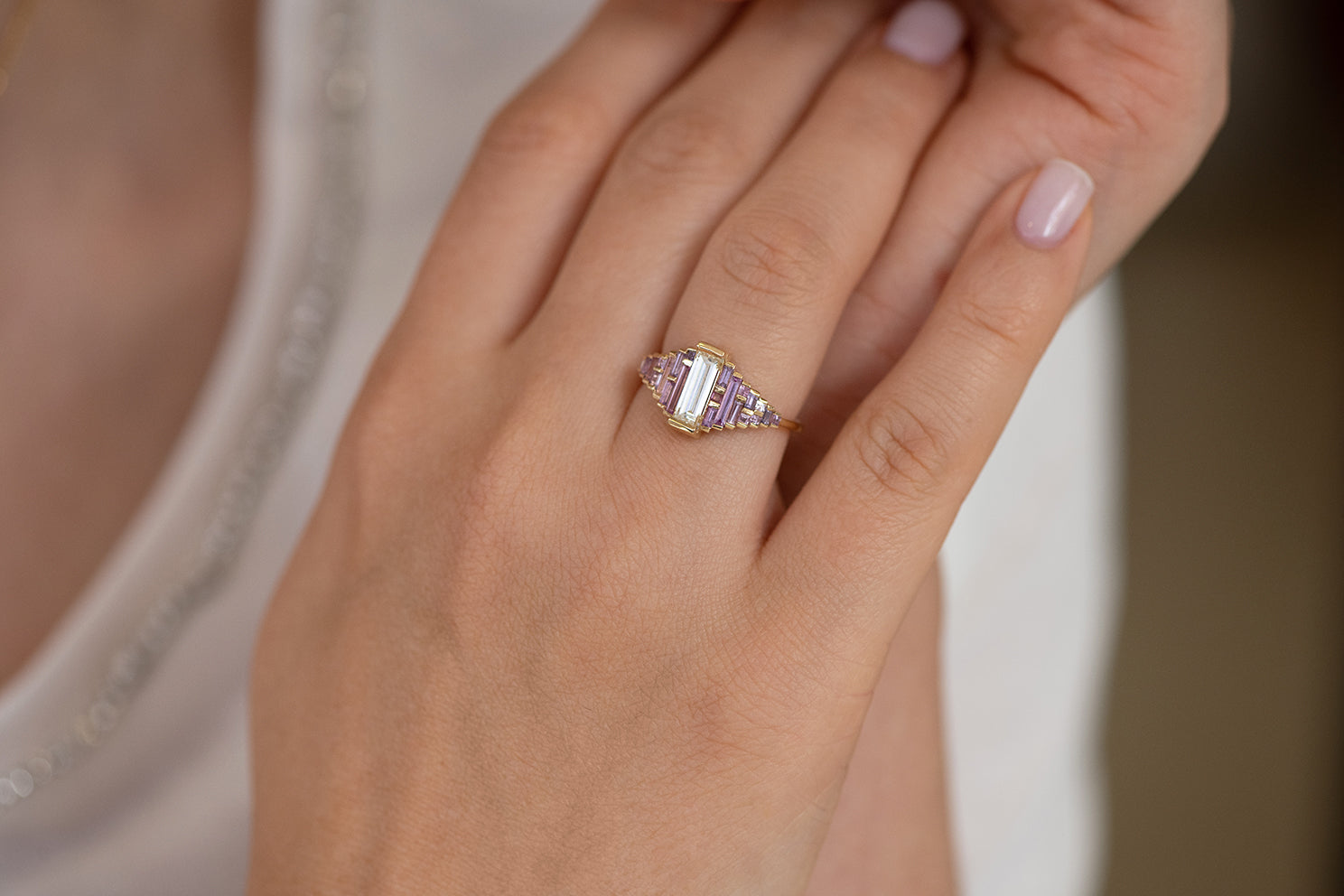 Purple and Lilac Sapphire Ring with Baguette Diamond on Hand Baguette Illuminated
