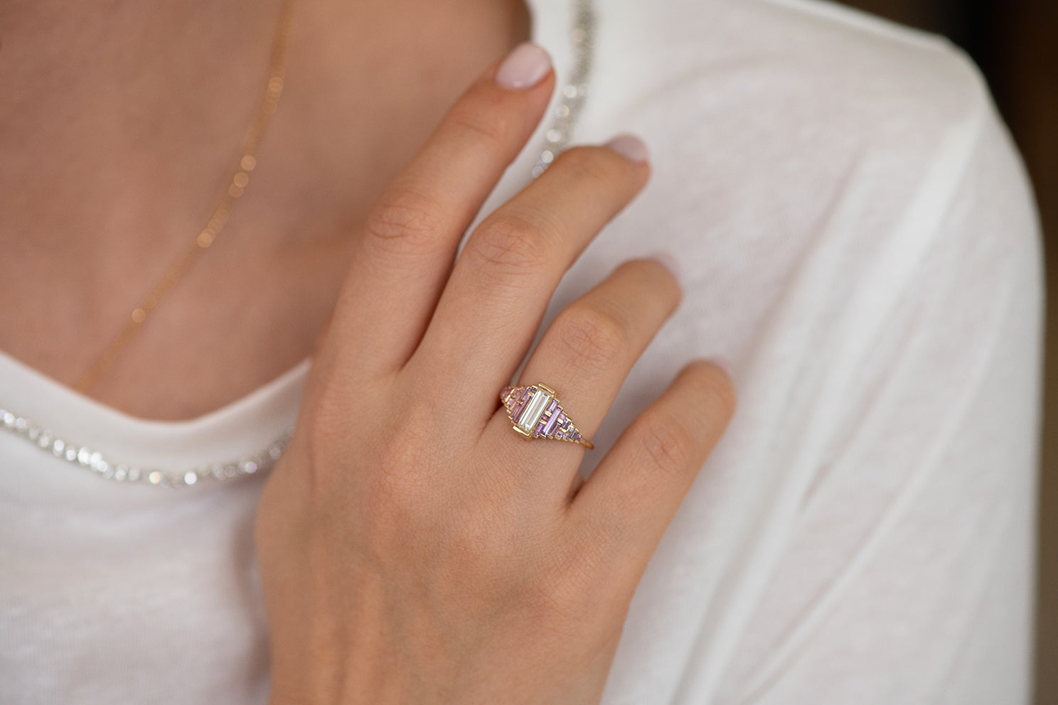 Purple and Lilac Sapphire Ring with Baguette Diamond on Hand Alternate Angle