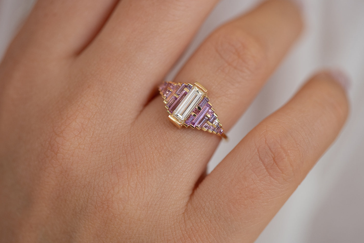 Purple and Lilac Sapphire Ring with Baguette Diamond Up Close on Hand