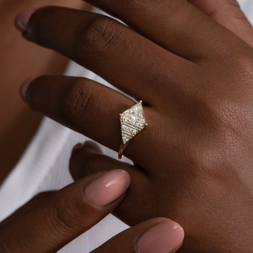 Rhombus-Engagement-Ring-with-Mixed-Diamond-Cuts-on-finger