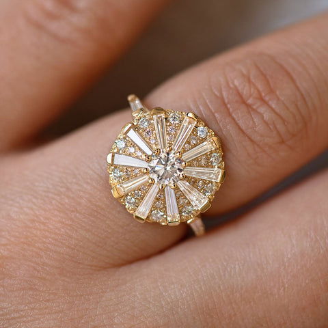 Round Engagement Ring with Long Tapered Baguette Diamonds on Hand up close detail shot