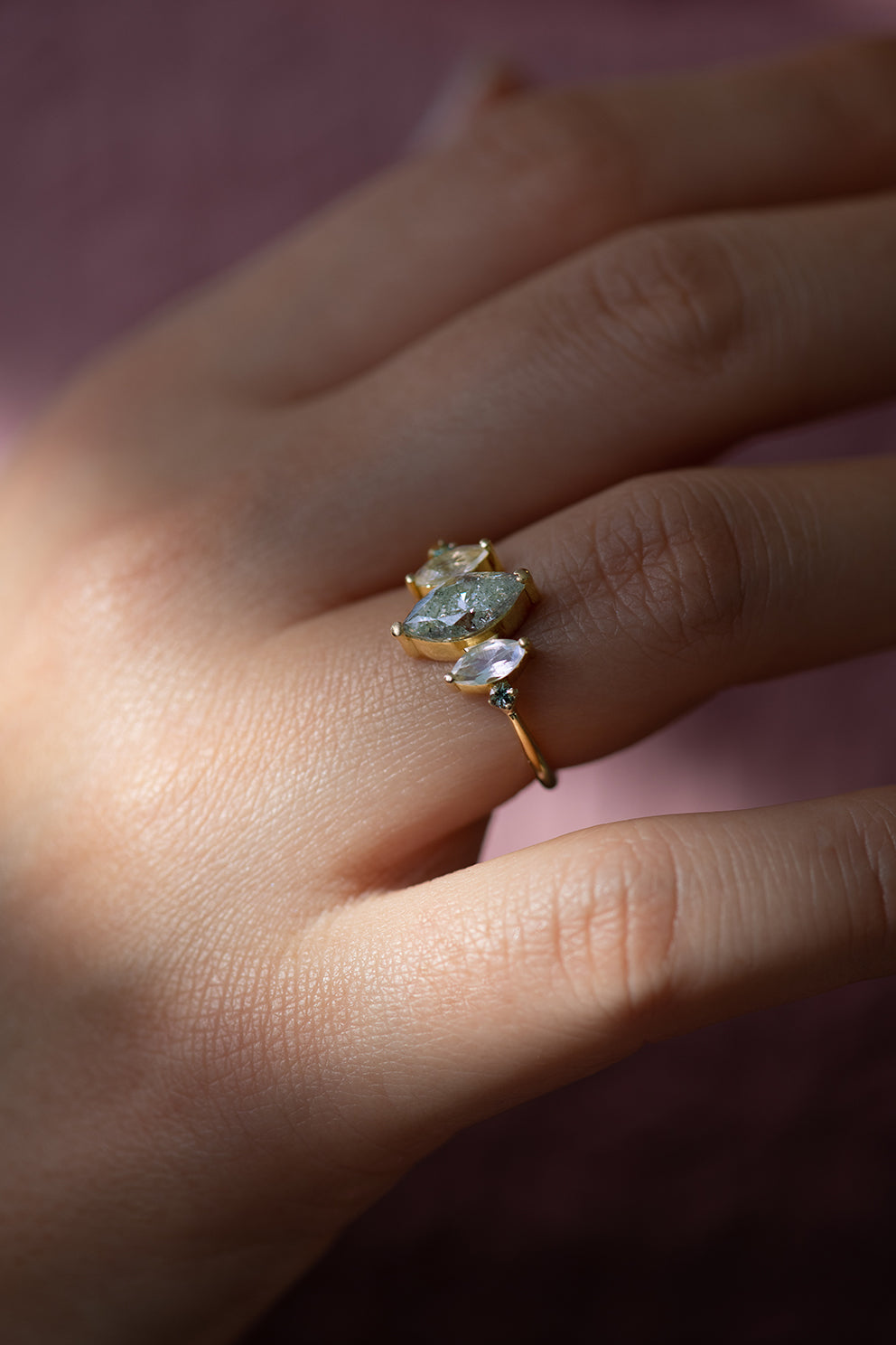 Salt and Pepper Marquise Diamond Ring Up Close in Light Shaft on Hand