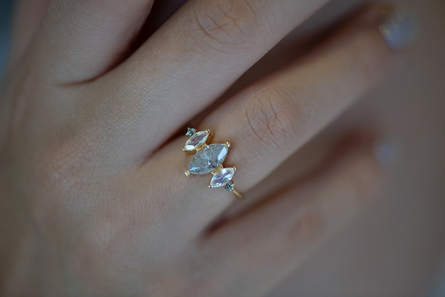 Salt and Pepper Marquise Diamond Ring in Shadow on Hand Up Close Shot