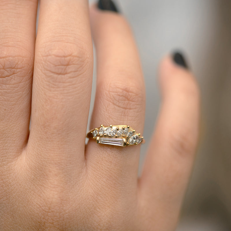 Gliding Tapered Baguette Cluster Ring