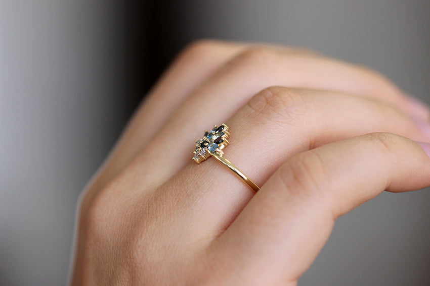 Side View Of Aquamarine Engagement Ring On Ring Finger
