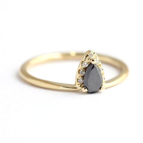 side view of Black Diamond Pear Engagement Ring With White Diamond Accents