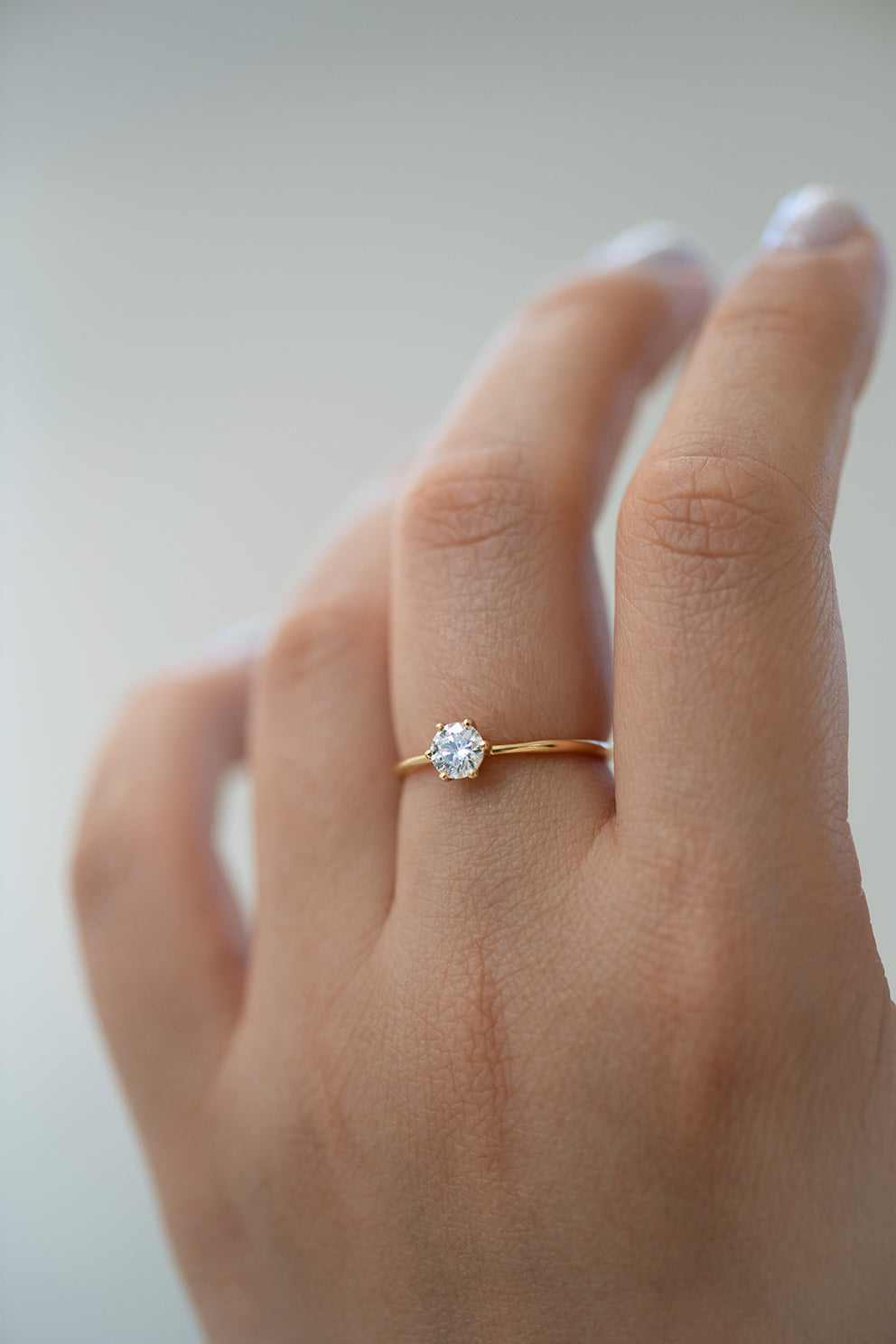 Solitaire Engagement Ring - Minimalist Diamond Ring Up Close on Hand