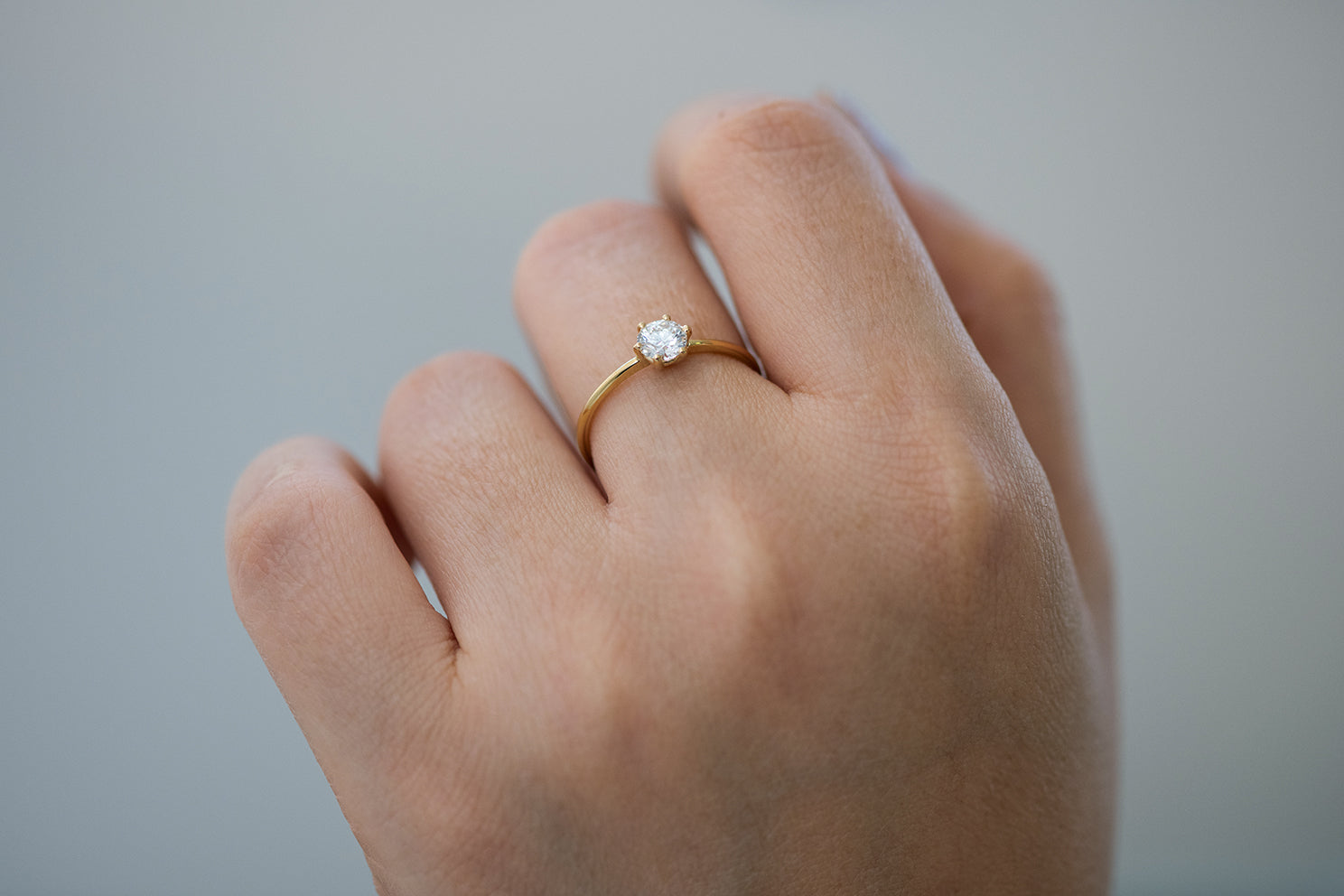 Solitaire Engagement Ring - Minimalist Diamond Ring on Hand Under View