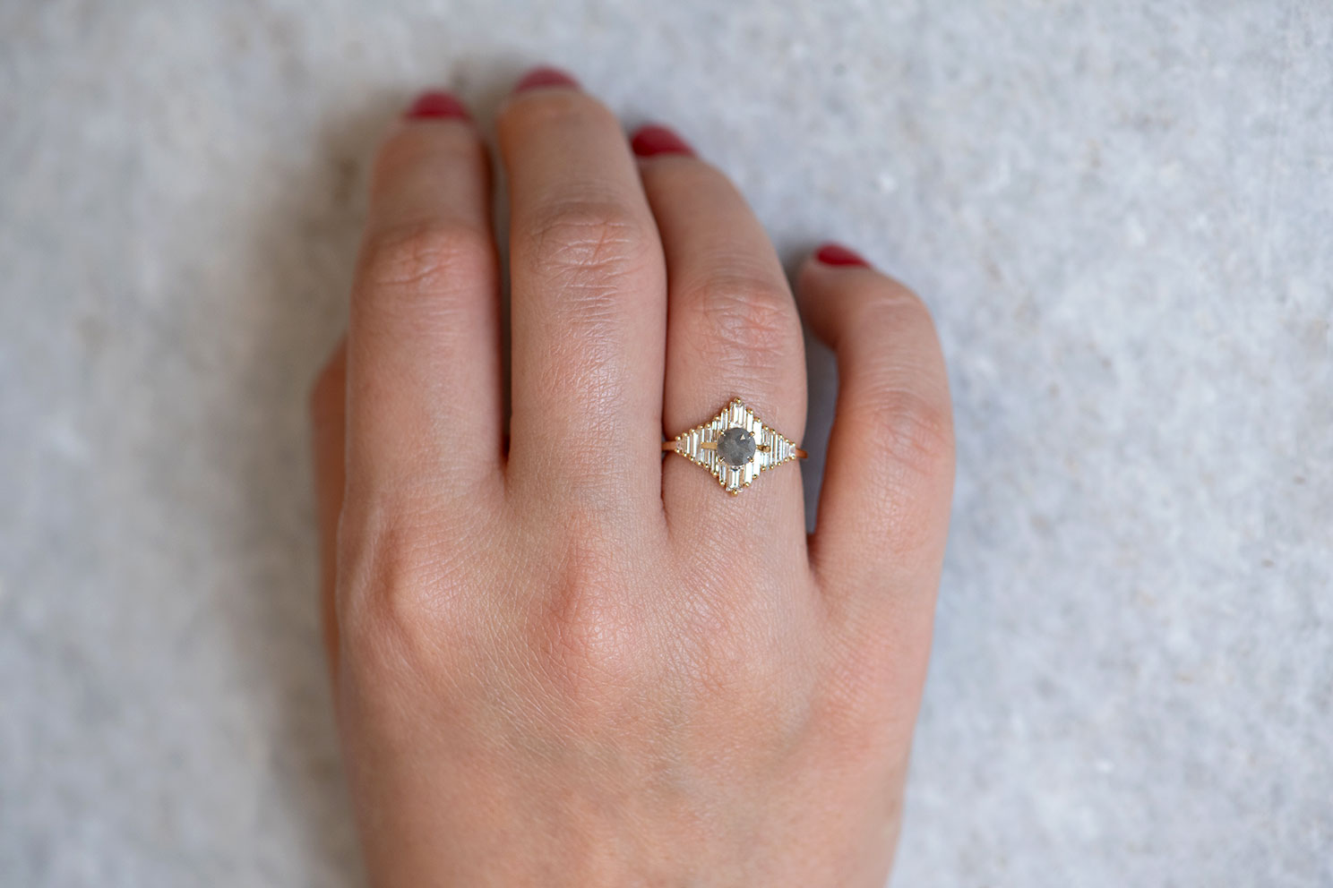 Star Engagement Ring with Baguette and Rose Cut Diamonds on Hand frontal angle