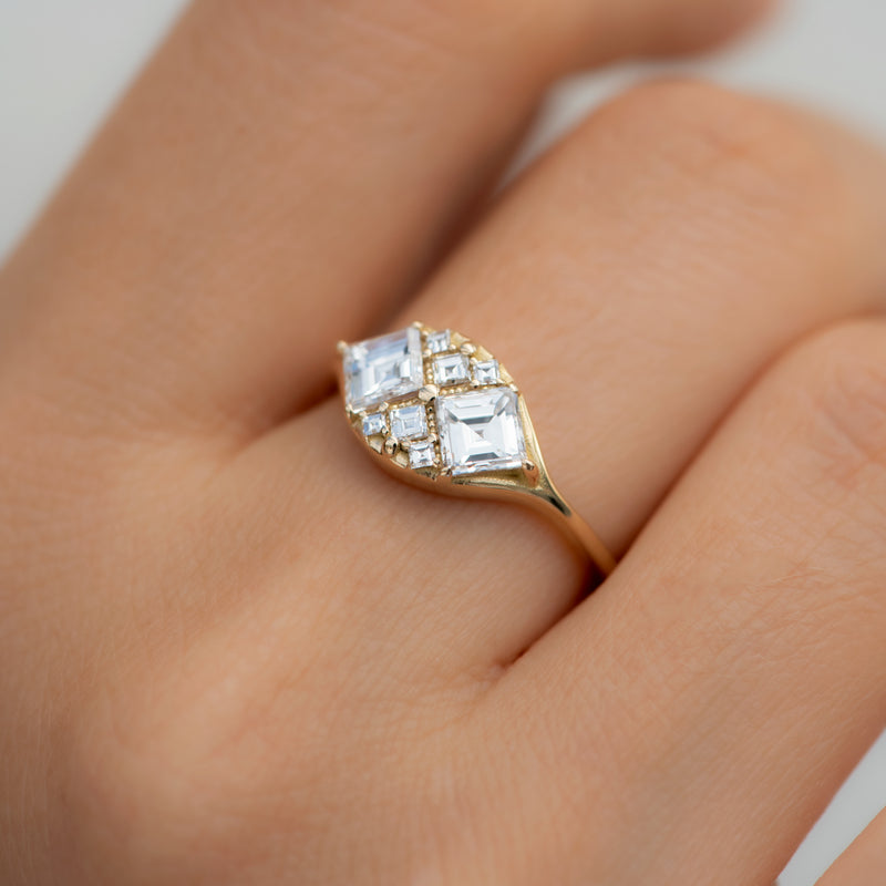 Step-Cut-Engagement-Ring-with-Eight-Square-Diamonds-gold