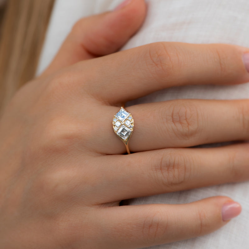 Step-Cut-Engagement-Ring-with-Eight-Square-Diamonds-sparking